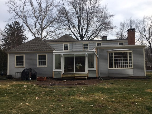 Exterior Patio Enclosed to an All Season Sunroom Addition