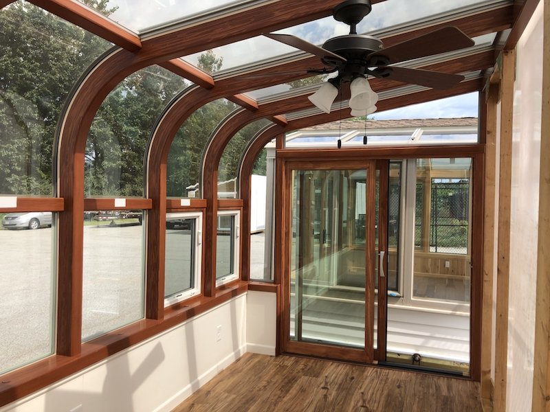 Year-Round Curved Eave Display Sunroom