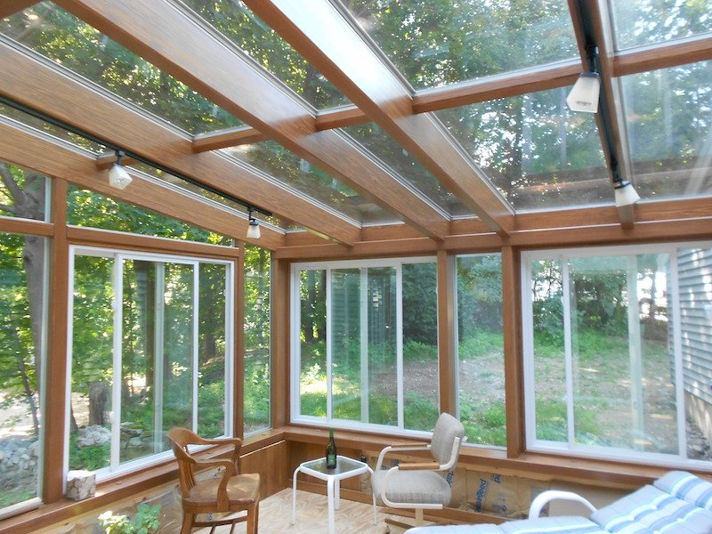 MA All-Season Sunroom Addition with Custom-Stained Wood Beams