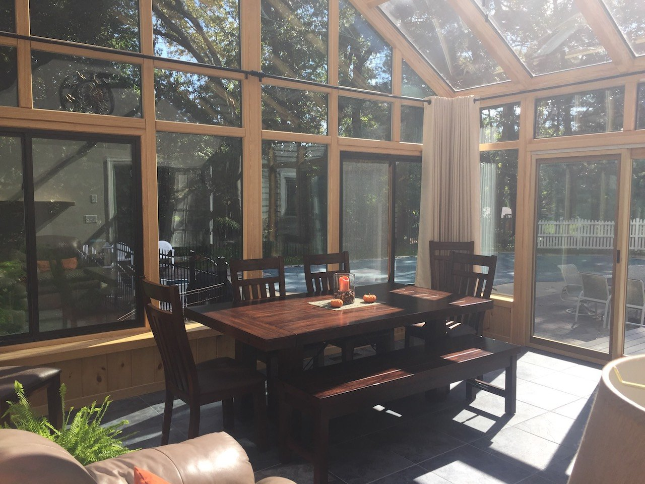 MA All-Season Sunroom with Living and Dining Areas